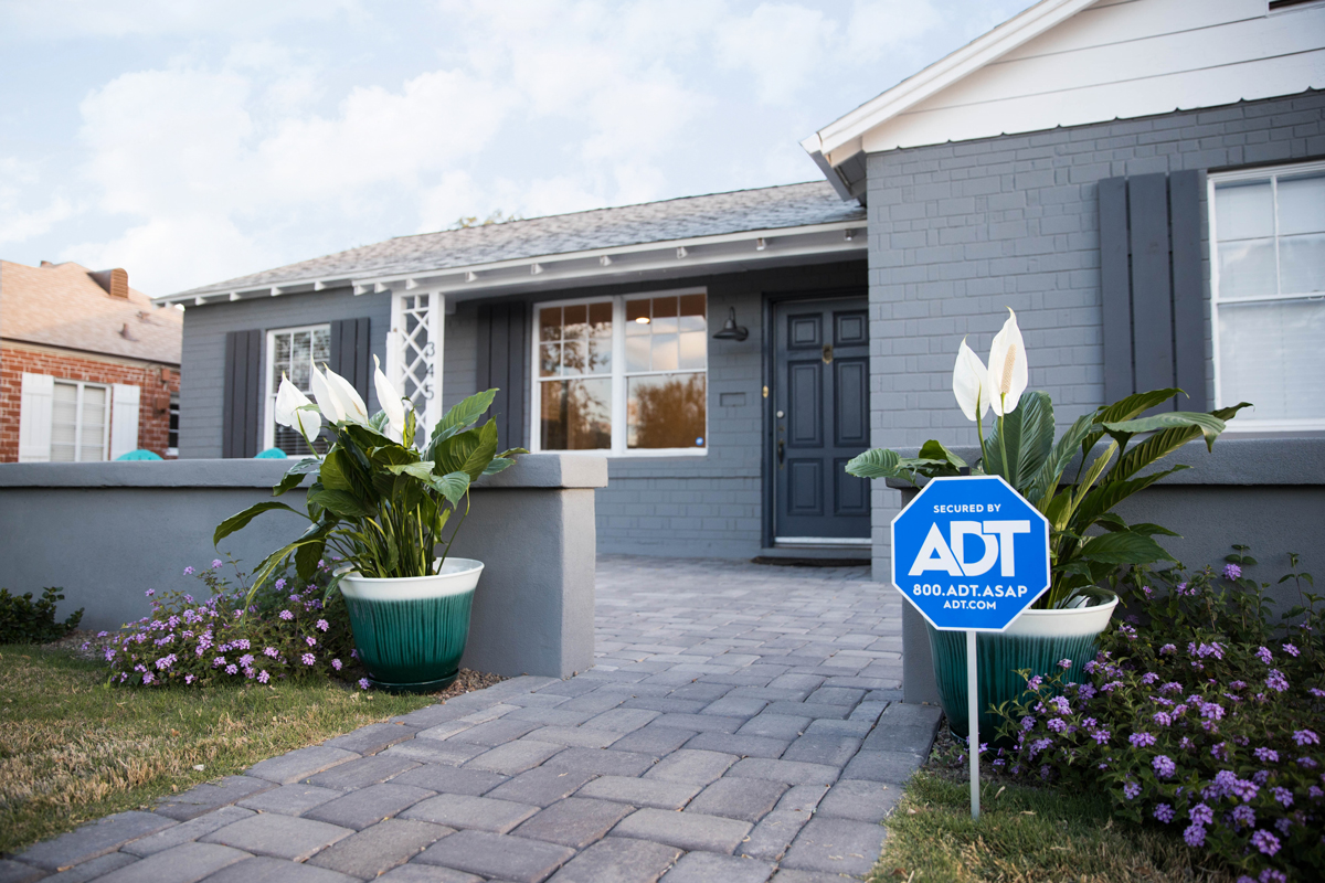 ADT protected house with front yard sign